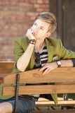 Young handsome man sitting on bench Royalty Free Stock Image