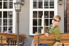 Young handsome man sitting on bench Royalty Free Stock Photo