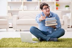 The young handsome man sitting on floor at home Royalty Free Stock Photo