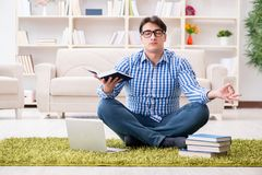 The young handsome man sitting on floor at home Stock Photography