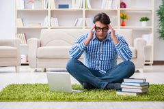 The young handsome man sitting on floor at home Stock Photo
