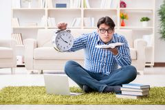 The young handsome man sitting on floor at home Stock Image