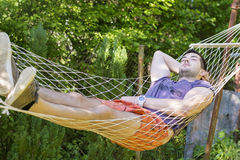 Young handsome man sleeping  In Hammock Royalty Free Stock Photography
