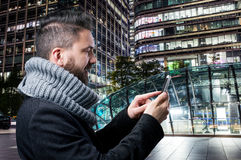 Young handsome man with smart phone in London city Royalty Free Stock Photography