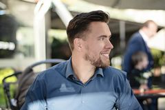 Young handsome man smiling profile portrait royalty free stock photo