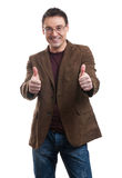 Young handsome man smiling and showing thumbs up Stock Photos