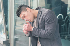 Young handsome man smoking a cigarette Stock Images