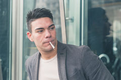 Young handsome man smoking a cigarette Stock Photography