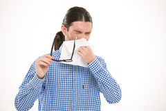 Young handsome man sneezing and using handkerchief Royalty Free Stock Photography