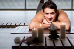 The young handsome man during spa procedure. Young handsome man during spa procedure royalty free stock photo
