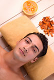 The young handsome man during spa procedure. Young handsome man during spa procedure stock photography