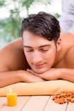 The young handsome man during spa procedure Stock Images