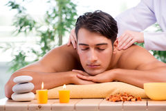 The young handsome man during spa procedure Stock Photos