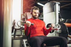 Young handsome man in sportswear exercising. At gym Stock Photo