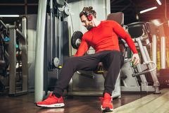 Young handsome man in sportswear exercising. At gym Royalty Free Stock Images