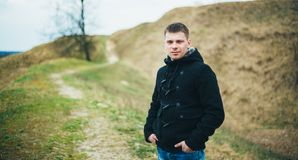 Young Handsome Man Stayed In Field, Meadow In Stock Images