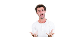 A young handsome man stressed out and yelling out Stock Images