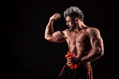 young handsome man with strong muscles, protein drink after training stock photos