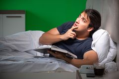 The young handsome man suffering from insomnia at home. Young handsome man suffering from insomnia at home stock image