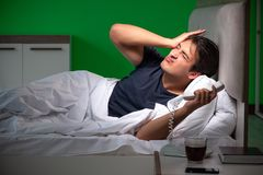The young handsome man suffering from insomnia at home. Young handsome man suffering from insomnia at home royalty free stock images