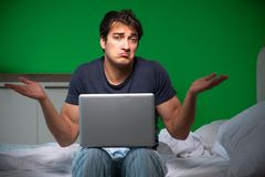 The young handsome man suffering from insomnia at home. Young handsome man suffering from insomnia at home royalty free stock photo