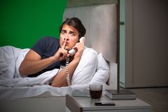 The young handsome man suffering from insomnia at home. Young handsome man suffering from insomnia at home stock photos