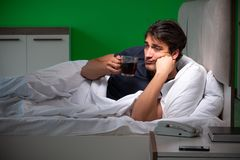 The young handsome man suffering from insomnia at home. Young handsome man suffering from insomnia at home stock images