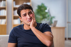 The young handsome man suffering from pain Royalty Free Stock Photos