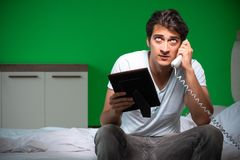 The young handsome man suffering from unrequited love in the bedroom stock photography