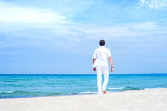 Young and handsome man on a summer beach Stock Photography