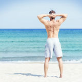 Young and handsome man on a summer beach Royalty Free Stock Image