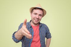 Young man in summer hat shake hand with you stock photos