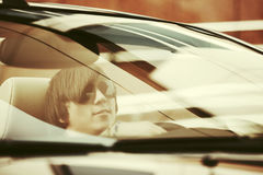 Young handsome man in sunglasses driving a car. Young handsome man in sunglasses driving convertible car Stock Photo