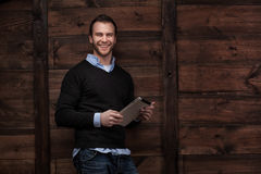 Young handsome man with a tablet Royalty Free Stock Photos