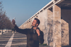 Young handsome man taking a selfie Stock Image