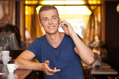 Young handsome man talking on phone. Stock Images