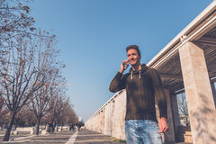 Young  handsome man talking on phone Stock Photography
