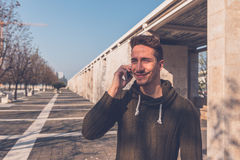Young  handsome man talking on phone Stock Images