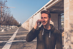Young  handsome man talking on phone Royalty Free Stock Photos