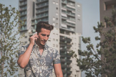 Young handsome man talking on phone in the street Royalty Free Stock Images