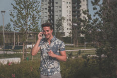 Young handsome man talking on phone in the street Stock Images