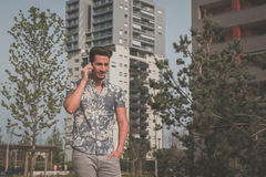 Young handsome man talking on phone in the street Royalty Free Stock Photo
