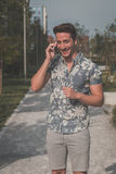 Young handsome man talking on phone in the street Royalty Free Stock Photography