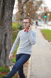 Young handsome man talking on smart phone Royalty Free Stock Photos