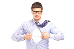 Young handsome man tearing off his shirt Stock Photography