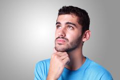 Young handsome man think Royalty Free Stock Images