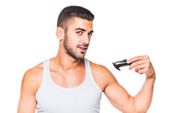Young handsome man trimming his beard Stock Image