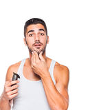 Young handsome man trimming his beard Royalty Free Stock Image