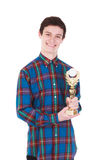 Young handsome man with trophy isolated on white. Background Royalty Free Stock Photos
