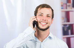 Young handsome man using cell phone Royalty Free Stock Photo